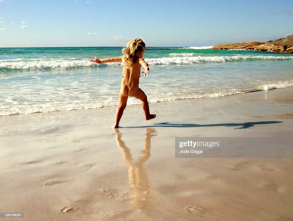 Nudist young beach boy