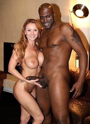 White girl holding black cock