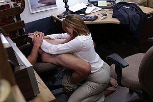Mature secretary bent over desks