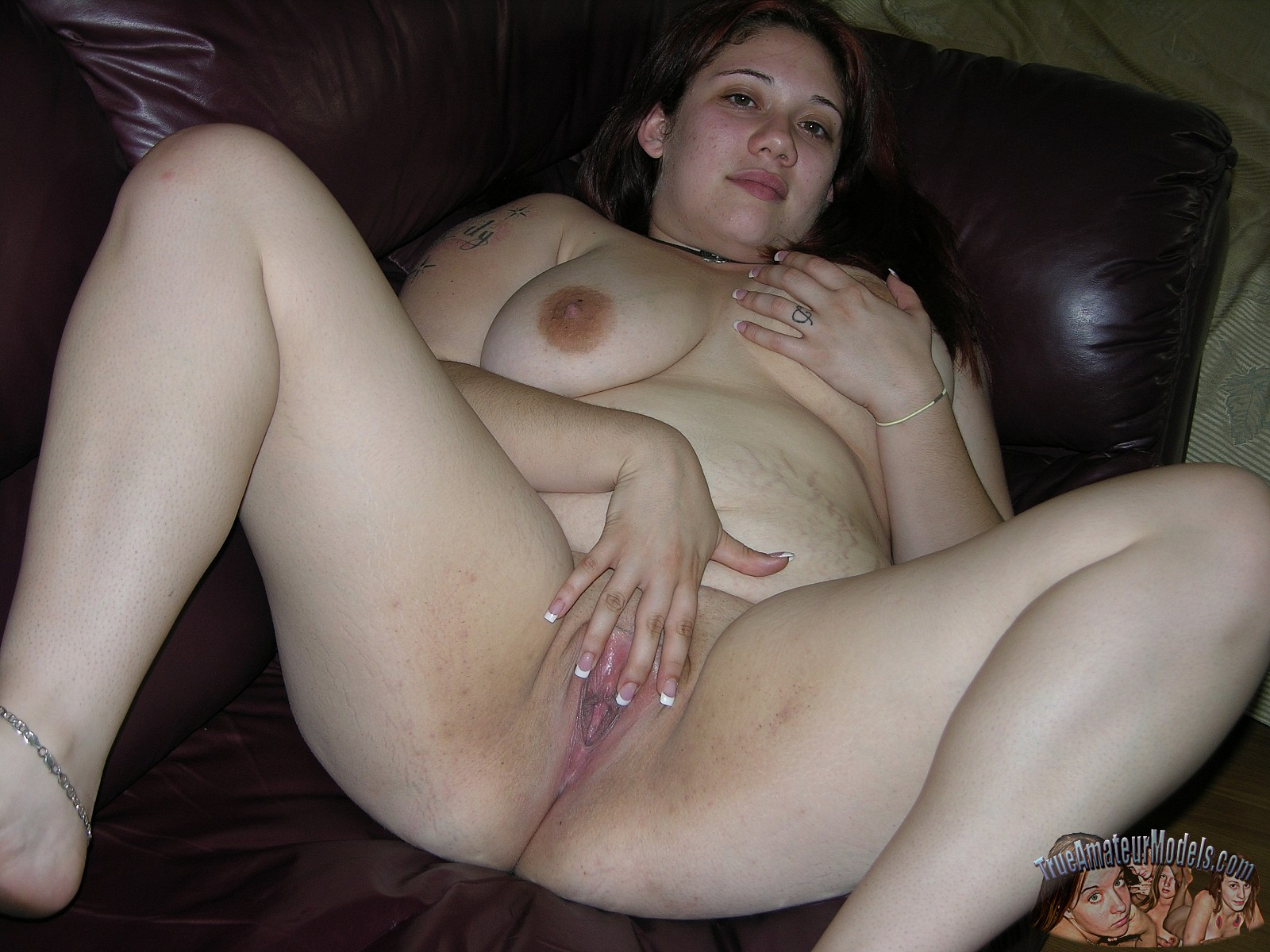 Chubby amateur girl spreads her pussy