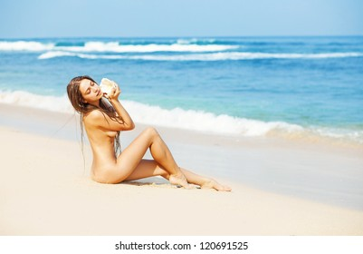 Nude women tanning on the beach