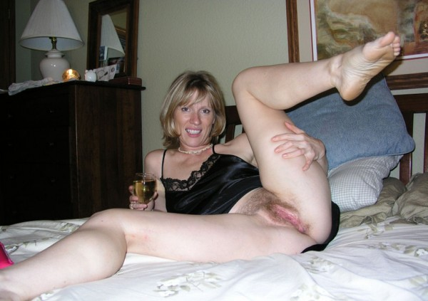 Shows her hairy pussy