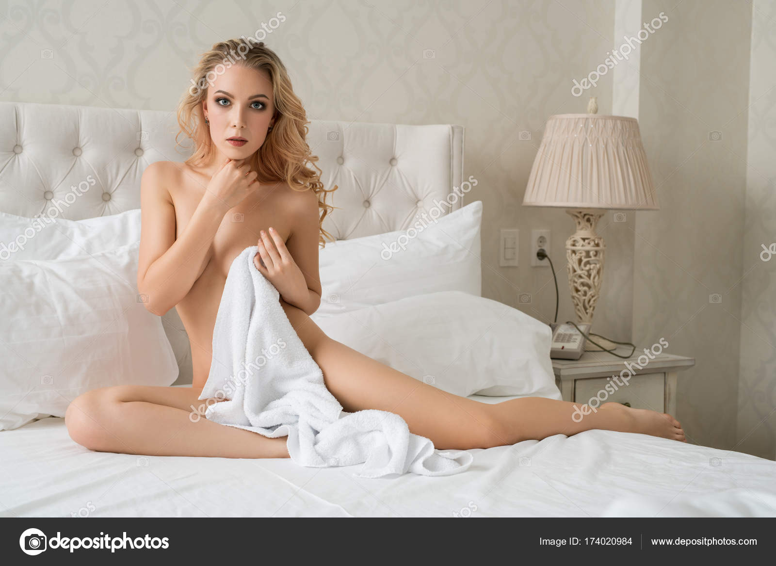 Nude blonde hotel room