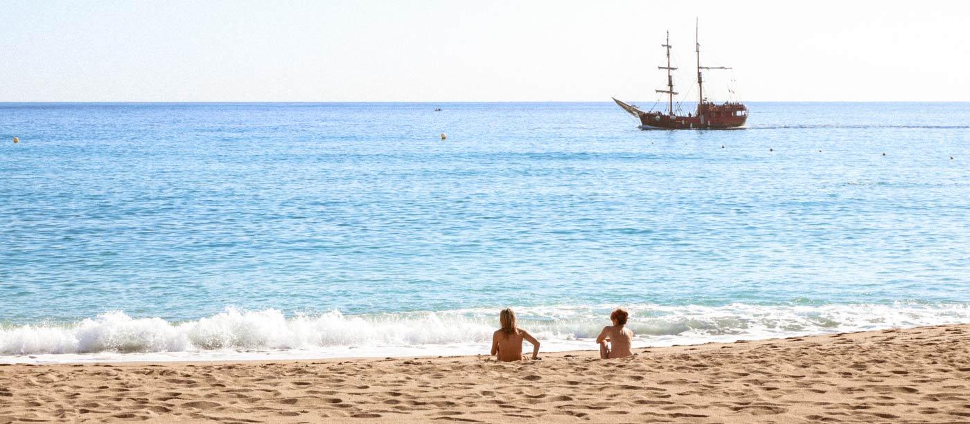 Teen playing nude on beach