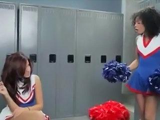 Lesbian cheerleaders in locker room kissing