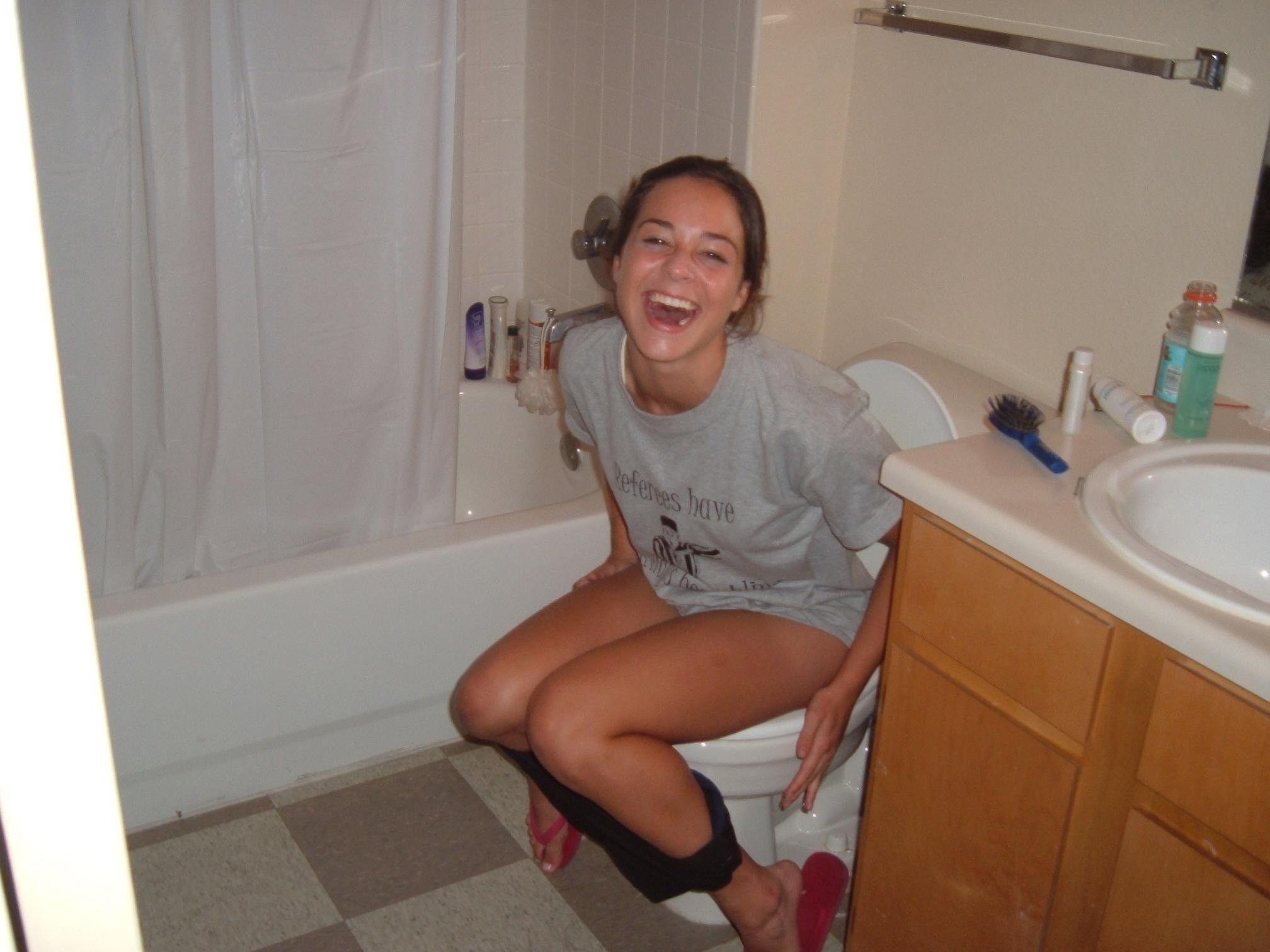 Girls pissing on toilet