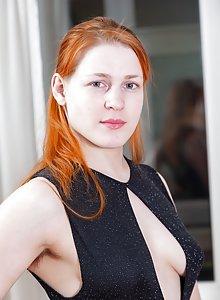 Redhead nude ass bending down