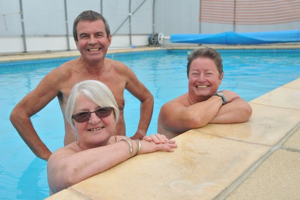Young family nudists spread