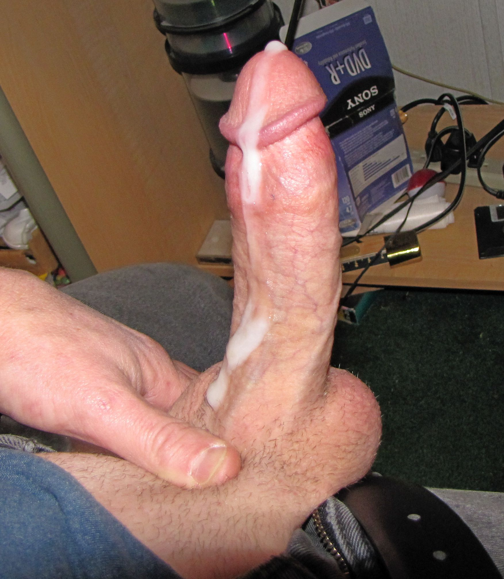 Cum oozing out of hard cock