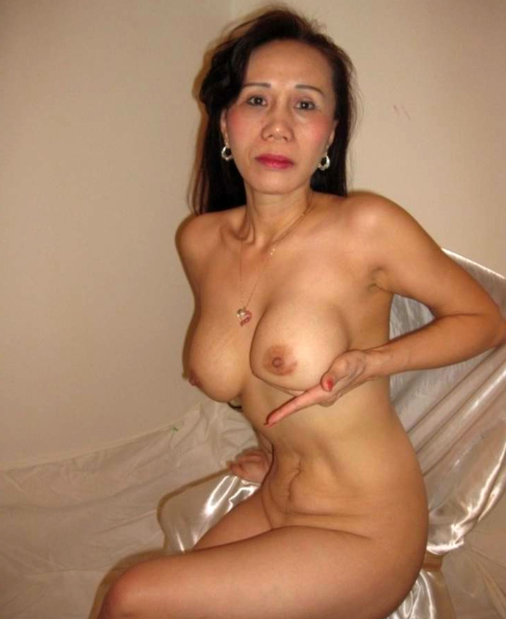 Asian women nude on bed