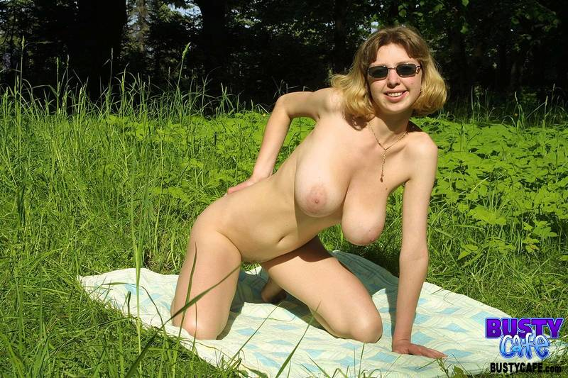 Busty nudes spread outdoors