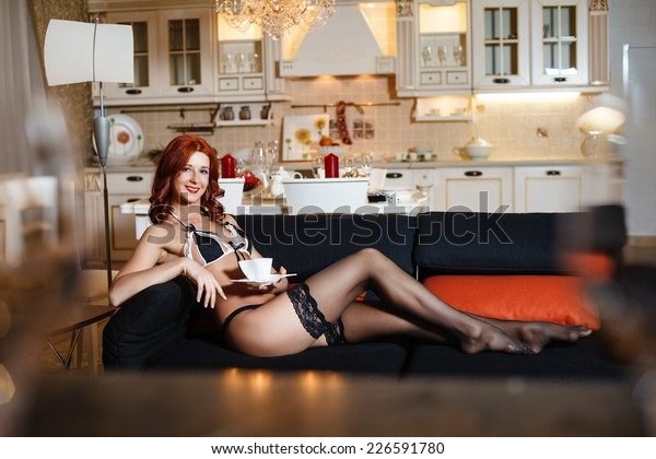 Naked woman drinking coffee