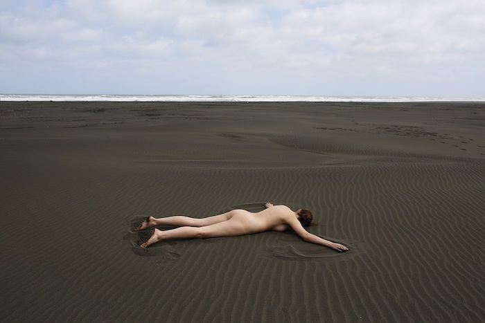 Naked women on bed face down