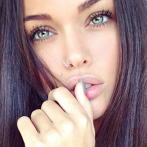 Beautiful girl with black hair green eyes