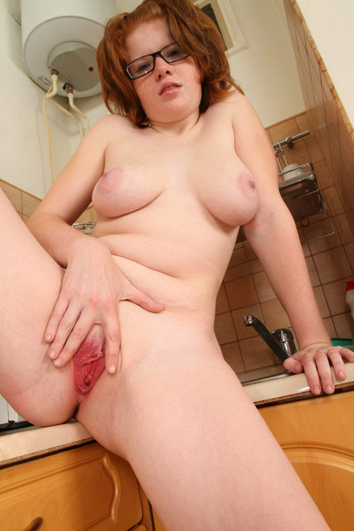 Chubby redhead milf fingering