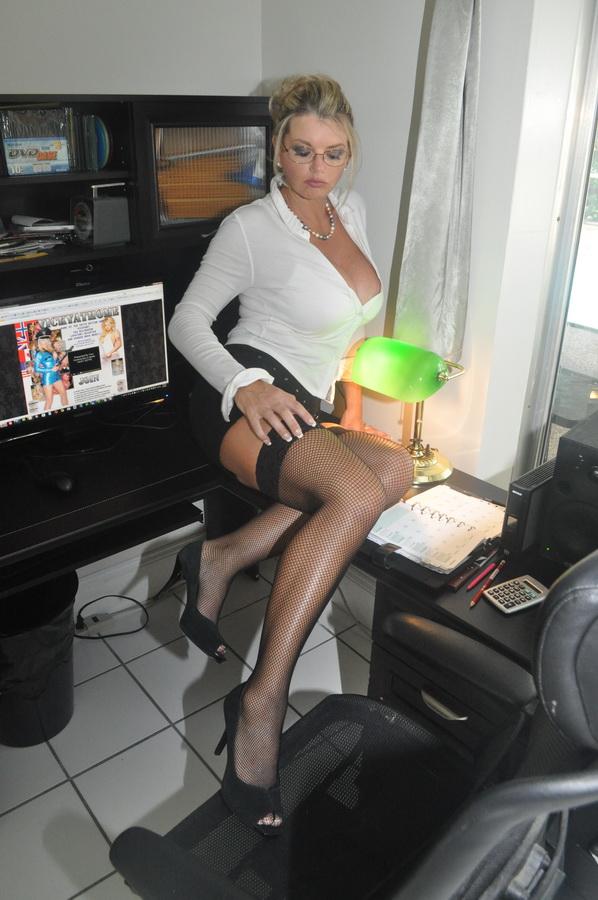 Horny secretary strips naked