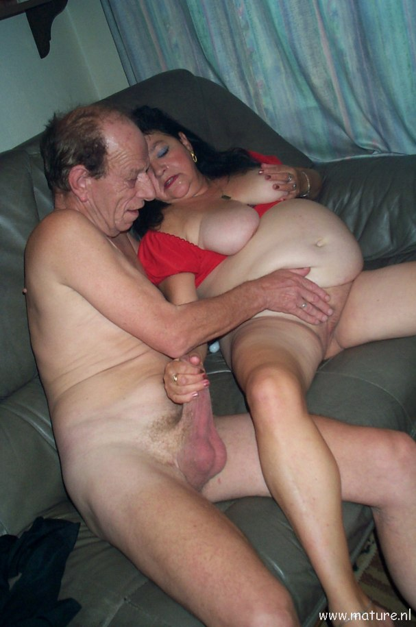 Mature couple having sex on the couch