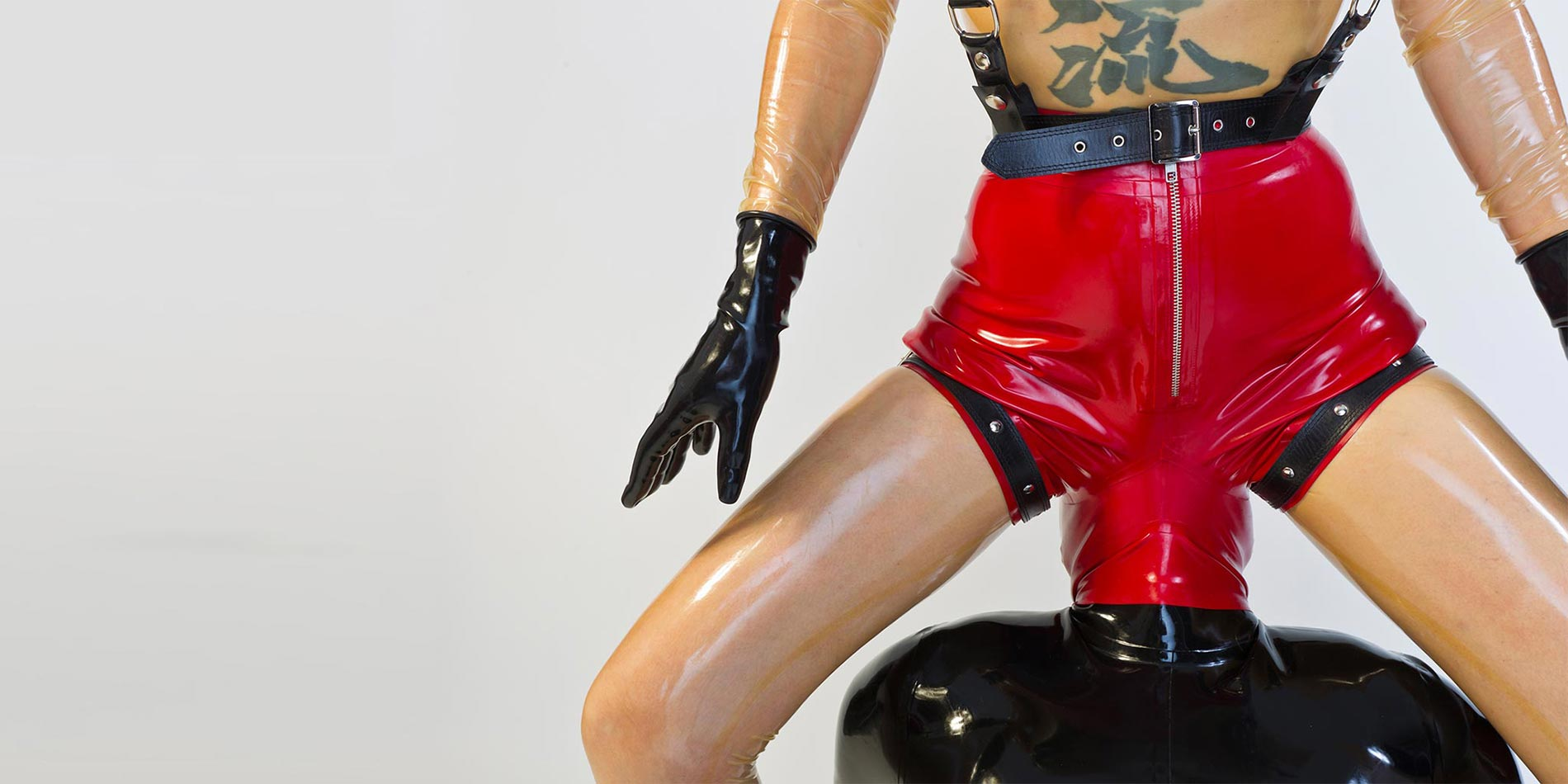 Strap on latex black twins