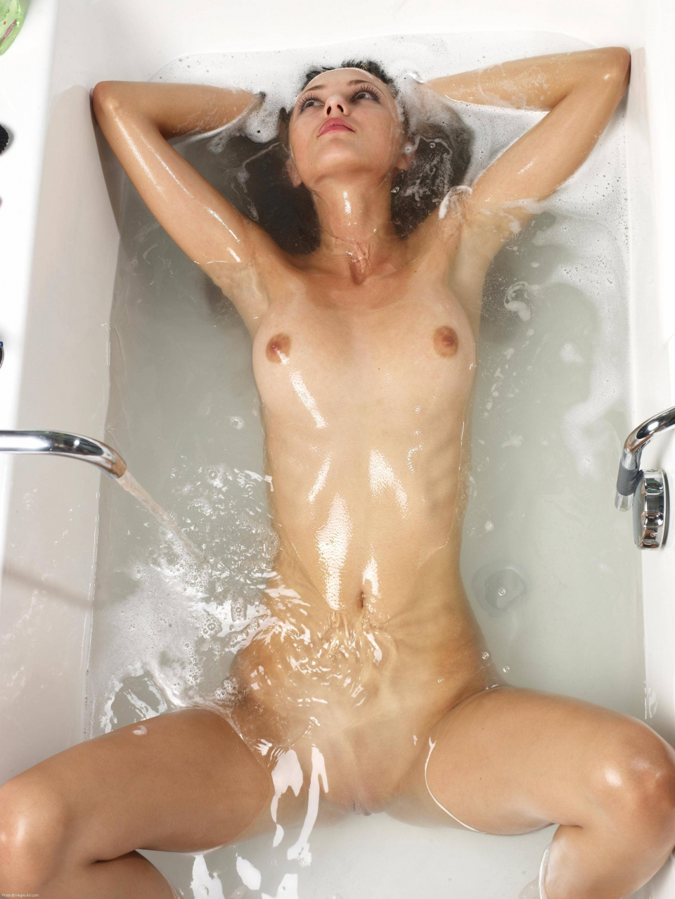 Naked girl in bath