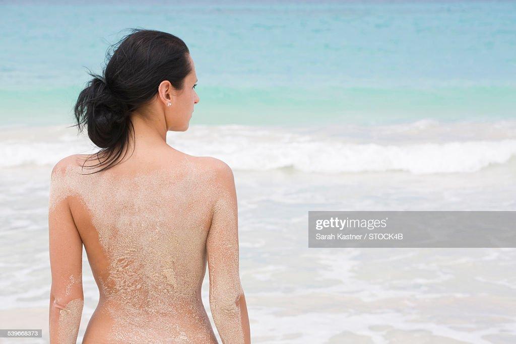 Nude woman in beach
