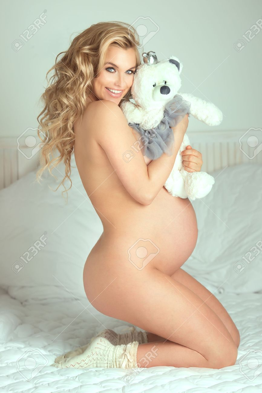 Pregnant blonde woman nude