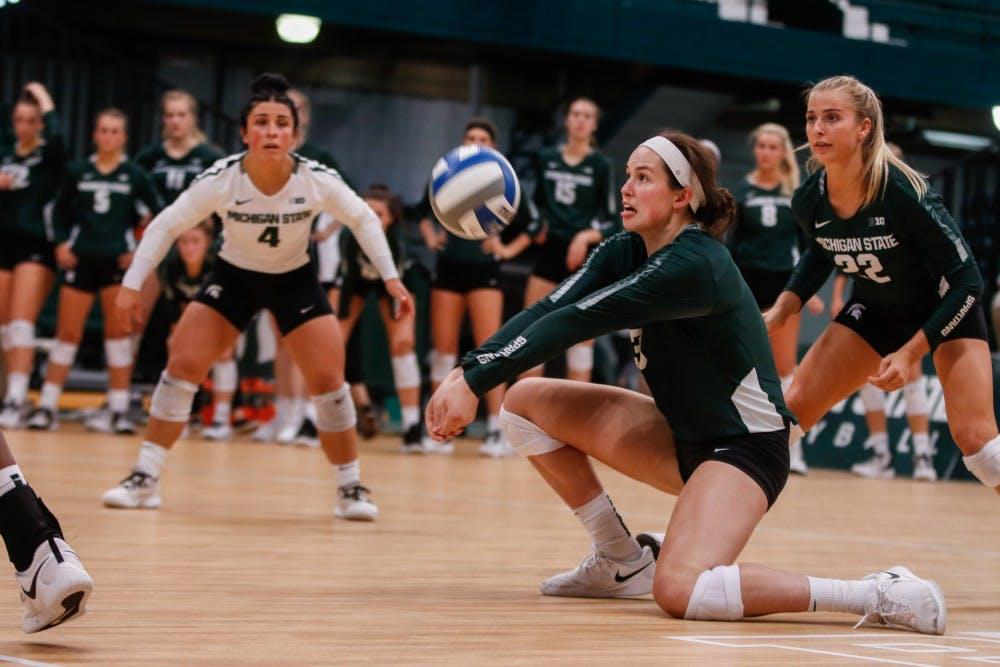 Volleyball girls doing splits